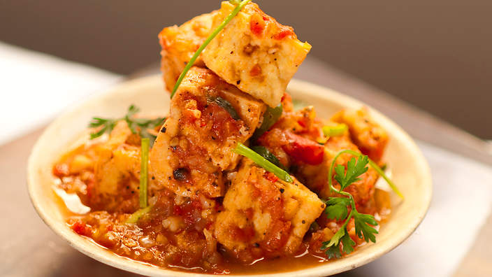 Bowl of tofu with tomato sauce