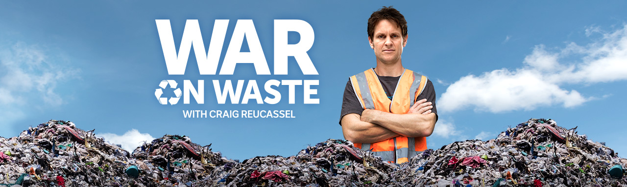 War On Waste with Craig Reucassel standing in a pile of waste